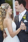 Loving newlyweds dancing on their wedding day