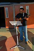 Guitarist Leading Hymn Singers