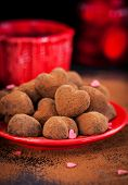 Heart Shaped Chocolate Truffles On Red Plate