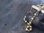 vintage handbag with shiny pearls on the wooden background