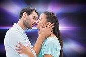 Attractive young couple about to kiss against digitally generated cool nightlife design