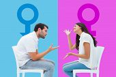 Couple sitting on chairs arguing against pink and blue