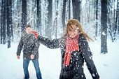 foto of snowball-fight  - Winter couple having fun playing snowball fight - JPG