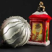 Red Lantern With Snowman And Children Decoration And Bright Christmas Ball