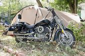Motorcycle Parked Near Tourist Tent