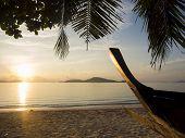 Beautiful sunrise in Rawai Phuket island Thailand with Long tailed boat Ruea Hang Yao