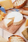 Soft cheese, brie or camembert, on wooden board