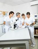Group of scientists working together in medical lab