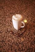 pic of latte  - A cup of cafe latte and coffee beans - JPG