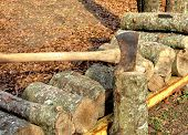Stacked firewood with axe