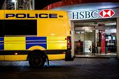 Police parked up outside a HSBC branch in Liverpool, UK