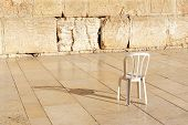 image of israel people  - An empty chair at the Kotel Wailing Western Wall empty at night in Jerusalem Israel - JPG
