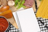 Folded Notebook With Ingredients For Spaghetti Bolognese