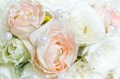 beautiful bridal bouquet of white and peach roses