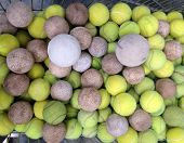 picture of softball  - Tennis ball with softball in iron basket - JPG