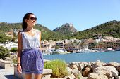 Port d'Andratx, Mallorca - tourist walking. Woman visiting city in sunglasses during summer.