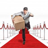 running worker with parcel on red carpet