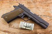 Close Up Money With Gun.
