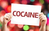pic of crack cocaine  - Cocaine card with colorful background with defocused lights - JPG
