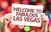 Welcome to Fabulous Las Vegas card with colorful background with defocused lights