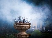Incense sticks burning in front of Temple of the Tooth, Kandy, Sri Lanka
