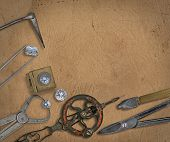 stock photo of work bench  - vintage jeweler tools and diamonds over  working bench - JPG