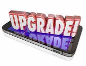 Upgrade word in red 3d letters on a cell or mobile phone to advertise the latest, newest model or device