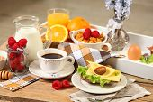 healthy continental breakfast on wooden table