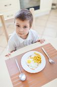 Portrait of boy with his breakfast