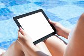 Woman Holding Digital Tablet At Poolside