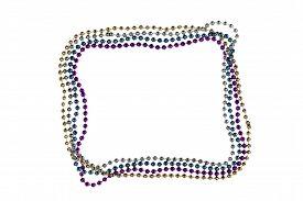 image of debauchery  - Shiny gold purple blue and silver Mardi Gras beads on white background - JPG