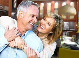 picture of grandma  - Happy senior loving couple over house background - JPG