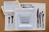 pic of table manners  - Option table setting with square plates and a complete set of forks knives and spoons - JPG