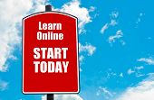 pic of start over  - Learn Online Start Today motivational quote written on red road sign isolated over clear blue sky background - JPG