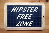 stock photo of sarcasm  - The phrase Hipster Free Zone in white text on a slate blackboard - JPG