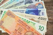 foto of currency  - Grouping of various international paper bill currency - JPG
