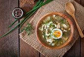 image of sorrel  - Green soup of sorrel in wooden  bowl - JPG