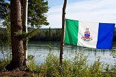 Yukon Flag In Front Of Yukon River