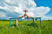 pic of gas-pipes  - Gas pipe with a tap valve in the summer - JPG