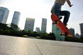 pic of skateboard  - closeup of skateboarder skateboarding at sunrise city - JPG