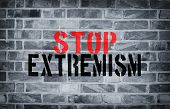 pic of isis  - Stop Extremism stencil print on the grunge white brick wall - JPG