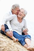 picture of couple sitting beach  - Senior Couple Sitting On Beach Together - JPG