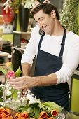 foto of over counter  - Male Florist In Shop Taking Order Over Telephone - JPG