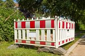 stock photo of safety barrier  - A small barrier protects a building site - JPG