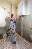 picture of convection  - pipefitter installing system of heating - JPG