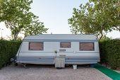 stock photo of caravan  - Caravan on a camping site in Spain - JPG