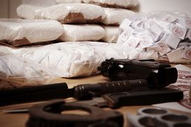stock photo of raw materials  - Drug packages raw opium drug dozens and weapons seized by police - JPG