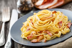 picture of carbonara  - Delicious pasta carbonara on a gray plate - JPG