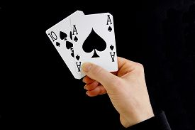 image of tens  - hand holding best classic winning blackjack combination ten and ace of spades - JPG