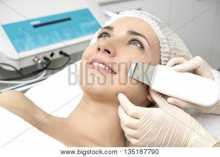 poster of Skin Care. Close-up Of Beautiful Woman Receiving Ultrasound Cavitation Facial Peeling. Ultrasonic Skin Cleansing Procedure. Beauty Treatment. Cosmetology. Beauty Spa Salon.